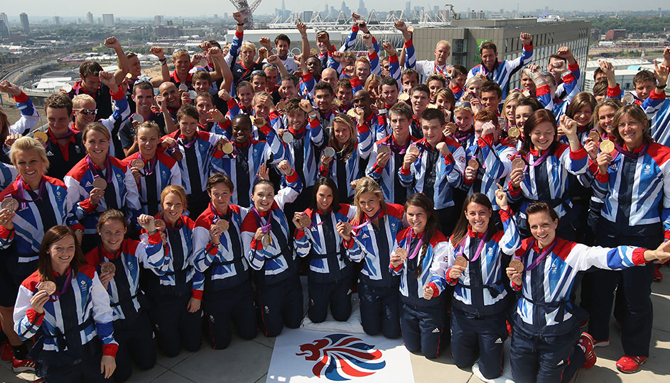 Team GB holding up their medals.
